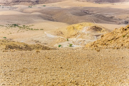 vadi: Sand and gravel hills and ravines in the mountain areas of Jordan. Desert mountain landscape Stock Photo