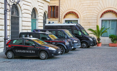 carabineer: Rome, Italy - June 25, 2014: Different size police cars parked in a quiet courtyard in the center of the Italian Rome. Police Car in italian capital Rome.