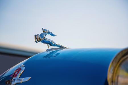 volga: KIEV, UKRAINE - April 26, 2015: The Retro OldCarFest in Kiev. Logo car Volga GAZ-21 close-up.