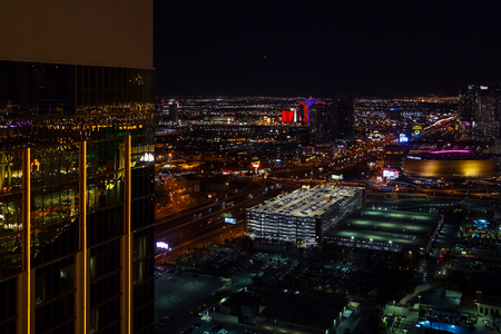 Las Vegas, USA - April 2018: Panoramic aerial view of the Las Vegas strip with casinos and hotels at night. Night view of Las Vegas from the hotel window.
