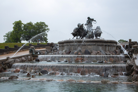 Gefion Fountain, Copenhagen, Denmark. Statue of man riding bulls by a fountain in the city of Copenhagen, Denmark. Gefion fountain is the largest fountain in Copenhagen.