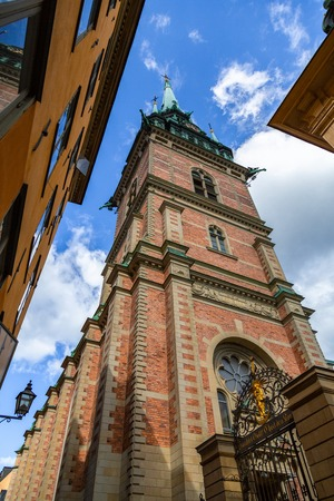 German Church in Stockholm old town Gamla stan, bottom view. Bell tower and spire of the German Church, Sweden, Stockholm.