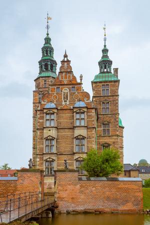Rosenborg castle on cloudy summer day in Copenhagen, Denmark. Rosenborg Slot castle in the Danish capital Copenhagen.