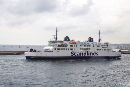 Helsinborg, Sweden - June, 2016: Scandlines is a freight forwarding company, passenger transport, truck and train, etc., between Denmark-Sweden ports. Scandlines departs from the harbor.