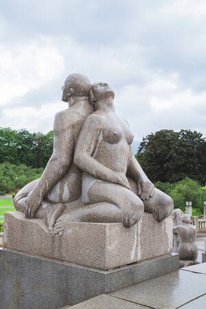 Oslo, Norway -Jule, 2016: Sculpture by Gustav Vigeland in the Vigeland Park at rainy weather. Famous rock sculpture park in Oslo, Norway. 報道画像