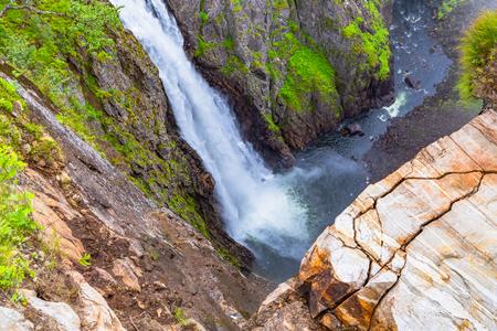 Falls in mountains of Norway. Waterfall Voringfossen - the fourth highest peak in Norway. Voringsfossen Waterfall. Hordaland, Summer Holiday in Norway Scandinavia. Banco de Imagens