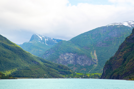 Panoramic view of Geiranger fjord near Geiranger seaport, Norway. Norway nature and travel background. View from the ferry on the fjord in Norway. Tourism holidays and travel.