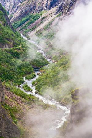 Beautiful view of the Voringsfossen waterfall. Bjoreio river. Norway. Falls in mountains of Norway. Waterfall Voringfossen - the fourth highest peak in Norway. Voringsfossen Waterfall. Banco de Imagens