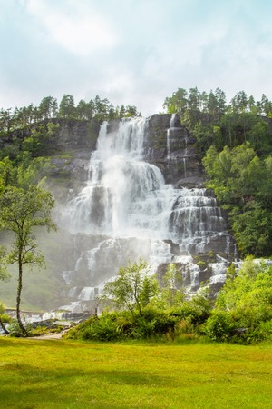 Falls in mountains of Norway in rainy weather. White waterfall. Tvindefossen Waterfall near Voss, Norway. Waterfall in mountains of Norway