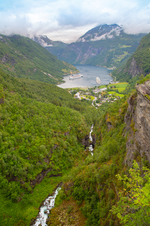 Panoramic view of Geiranger seaport, Norway. End of famous Geiranger fjord, Norway with cruise ship, top view. Geiranger seaport View Point. Norway nature and travel background.