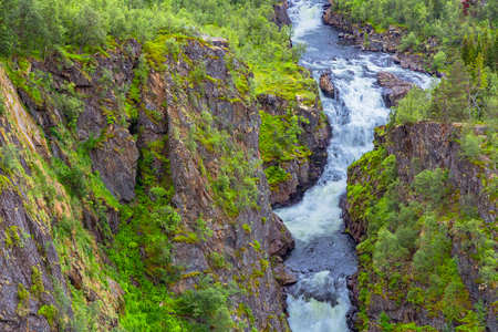 Falls in mountains of Norway. Waterfall Voringfossen - the fourth highest peak in Norway. Voringsfossen Waterfall. Beautiful view of the Voringsfossen waterfall. Bjoreio river. Norway. Banco de Imagens