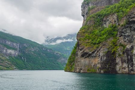 Panoramic view of Geiranger fjord near Geiranger seaport, Norway. Norway nature and travel background. View from the ferry on the fjord in Norway.