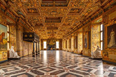 Hillerod, Denmark - June, 2016: Tourists are visiting the Grand Knights Hall of the Frederiksborg Castle. Interior of Renaissance Frederiksborg Castle - palace in Hillerod, now History Museum.
