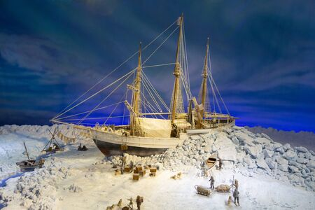 Oslo, Norway - July, 2016: Model of an old ship stuck in the ice of Antarctica. Sailors are trying to free the ship from the ice captivity. Exposition in the maritime museum in Norway.