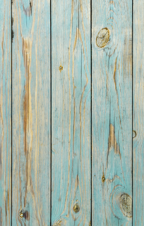 Faded blue wooden planks background. An old blue wooden fence. Blue wooden texture great as background. Rural blue wooden table background texture. Painted wood background. Close-up texture. Banco de Imagens