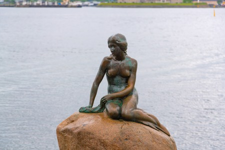Copenhagen, Denmark - June 2016: The sculpture of the little Mermaid in Copenhagen harbour. Little Mermaid statue in Copenhagen, Denmark.