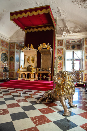 Hillerod, Denmark - June, 2016: Throne Hall of Frederiksborg Castle. The royal throne in the interior of the Frederiksborg Castle. 報道画像