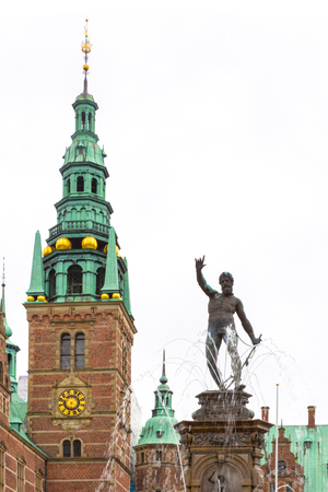 Hillerod, Denmark - June, 2016: View from entrance to Frederiksborg Castle. Neptune Fountain on the castles forecourt. Hillerod, Denmark. Front view of Frederiksborg castle in Hellerod, Denmark 報道画像