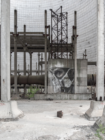 Chernobyl, Ukraine - April, 2019: Drawing graffiti on one of the concrete walls inside the Chernobyl Nuclear Power Station cooling tower, Chernobyl Exclusion Zone, Ukraine