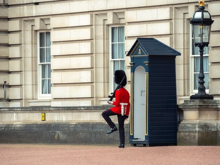 London, UK - April, 2019: Guards at Buckingham Palace. Solider of Buckingham palace, London England.