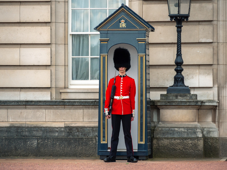 London, UK - April, 2019: English guard patrolling in London. Solider of Buckingham palace, London England.