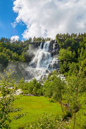 Falls in mountains of Norway in rainy weather. White waterfall. Tvindefossen Waterfall near Voss, Norway. Norway nature and travel background. 写真素材