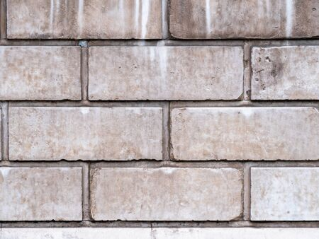 White background of old brick wall texture, close up. Brick Wall Texture. White brick wall closeup texture. Cracked grey grunge brick wall background.