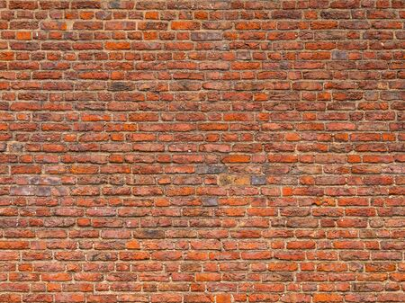 Red brick wall background texture. Background of old vintage red brick wall. Grunge red brick wall background with copy space. Old Brick Wall Background. Design template with place for text.