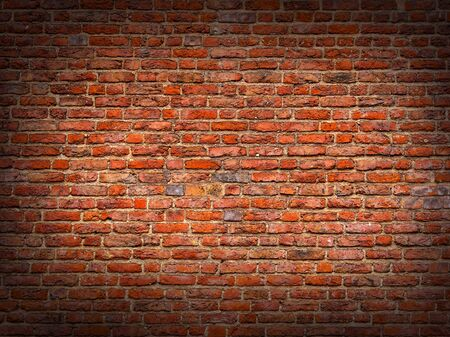 Red brick wall background texture with vignette. Background of old vintage red brick wall. Grunge red brick wall background with copy space. Old Brick Wall. Design template with place for text. 写真素材