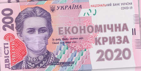 200 hryvnia banknote with Lesya Ukrainka in a medical mask with the inscription - ECONOMIC CRISIS 2020. Economic crisis has affected Ukraine, concept. Economic crisis after COVID-19