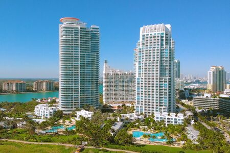 First line of buildings and hotels near the water of Miami South Beach. Aerial view of skyscrapers in Miami Beach. Front line with white skyscrapers and hotels in Miami. Aerial view near Miami Beach