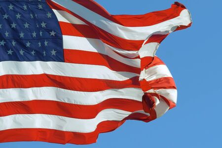 American flag waving proudly in the wind, representing. United States of America on a sunny day. USA flag fluttering in summer wind. Beautifully waving star and striped American flag