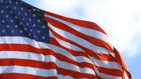 American flag waving proudly in the wind