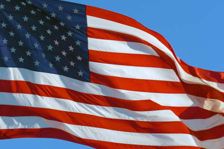 CLOSE UP: American flag waving in wind. Realistic USA Flag background. American Flag. Waved highly detailed fabric texture. American flag flying in the wind at sunny day