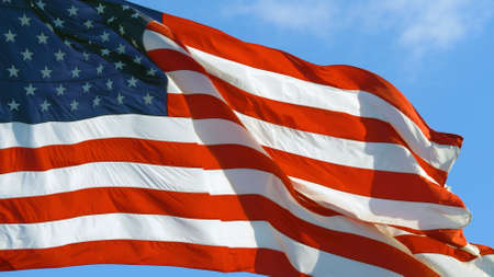 American flag USA Close Up waving background texture. Close up of USA flag waving in wind on a bright sunny day.