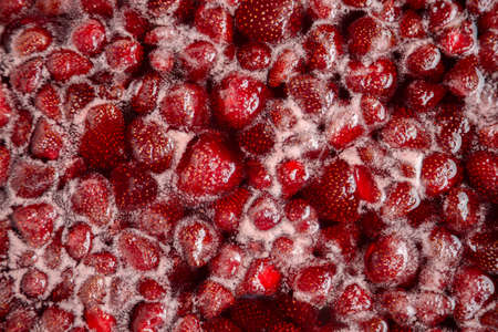 Strawberry jam is boiling, detailed shooting. Close-up of strawberry jelly boiling in a saucepan. Preparation of strawberry jelly