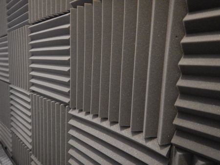 dampen: Acoustical foam or tiles for sound dampening. Music room. Soundproof room. Low key photo.