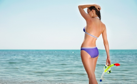Young woman with wet skin and with a snorkel Stock Photo - 9827440
