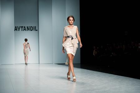 "KIEV, UKRAINE - OCTOBER 16: Fashion model wears clothes created by ""AVTANDIL"" at the 24th Ukrainian Fashion Week on Oct. 19, 2009 in Kiev, Ukraine."