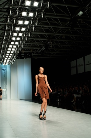evening class: KIEV, UKRAINE - OCTOBER 16: Fashion model wears clothes created by ANNA BUBLIK at the 24th Ukrainian Fashion Week on Oct. 16, 2009 in Kiev, Ukraine.