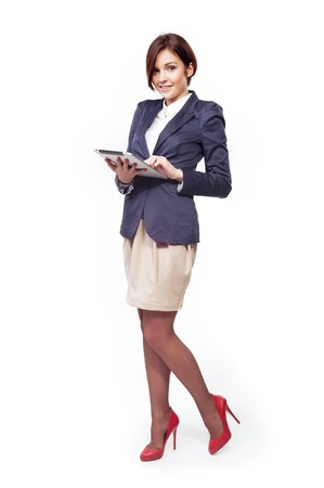 A full length portrait of a beautiful businesswoman with tablet