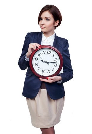A full length portrait of a beautiful businesswoman with clock photo