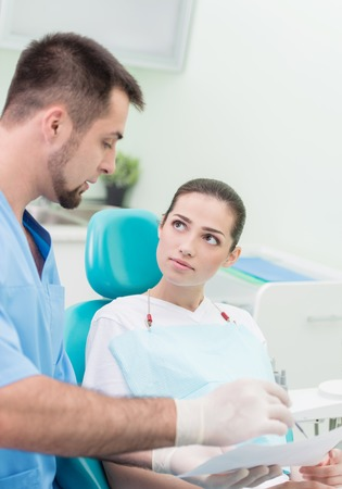 Woman having teeth examined at dentists - dentist Appointment