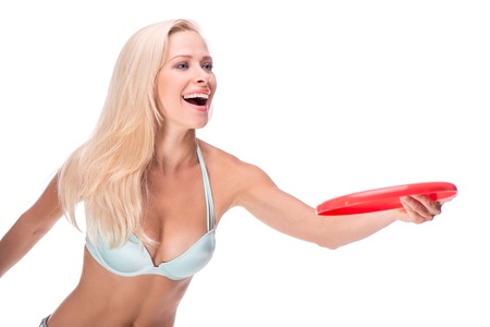 Full isolated studio picture with a young woman in swimsuit with frisbee