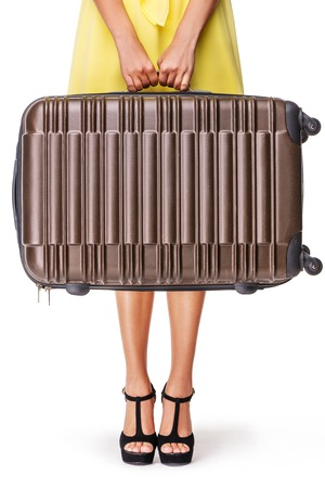 femme valise: Girl stands with brown suitcase and ready to travel