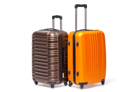Two travel suitcases on white background, studio shot
