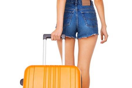 Photo of skinny beautiful woman carrying orange suitcase