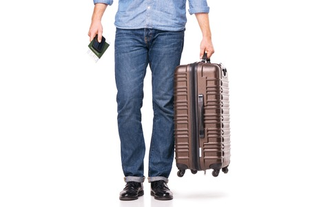lower section: Lower section of a traveler with luggage, passport, telephone and tickets