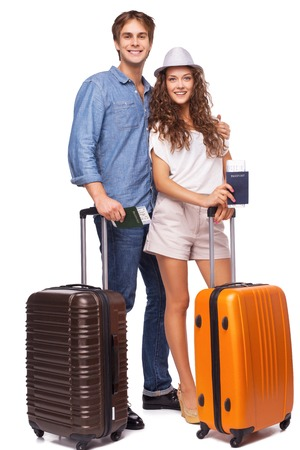 tourist tourists: Happy young couple is ready to travel and smiling
