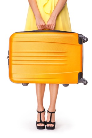 packing suitcase: Girl stands with orange suitcase and ready to travel Stock Photo